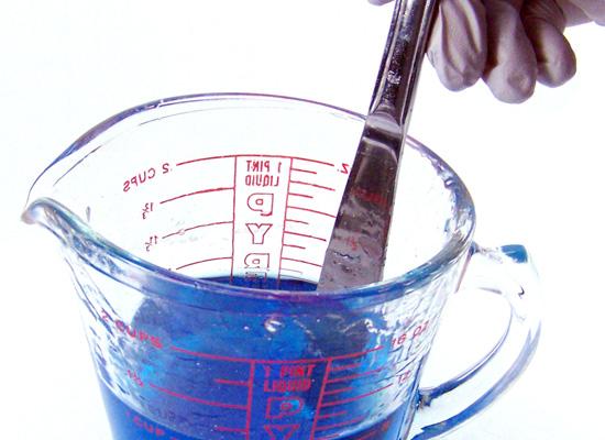 stirring blue into soap base