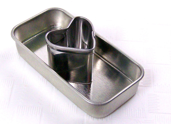 place heart cookie cutter into center of each tin