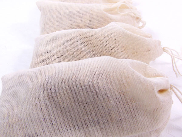 single use oatmeal shower scrub in muslin bag