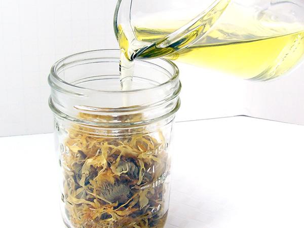 pour oil into jar