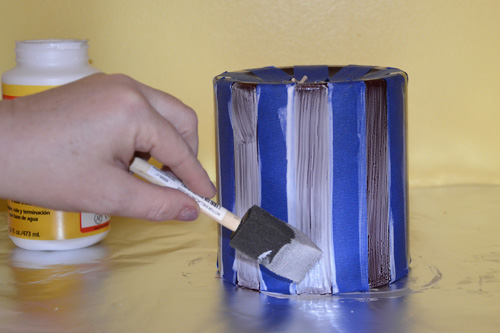 generously coat the candle with Mod Podge