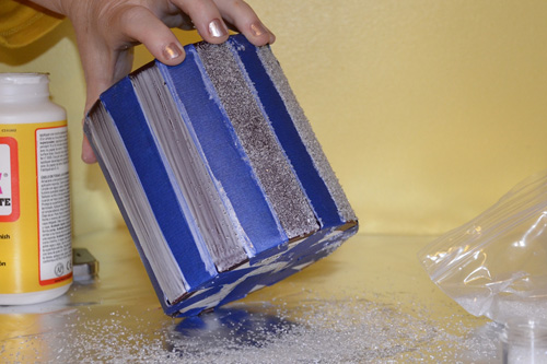 sprinkle glitter and/or dazzle dust onto glued area
