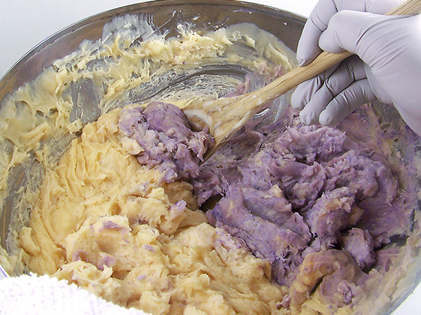 stir purple soap into uncolored soap