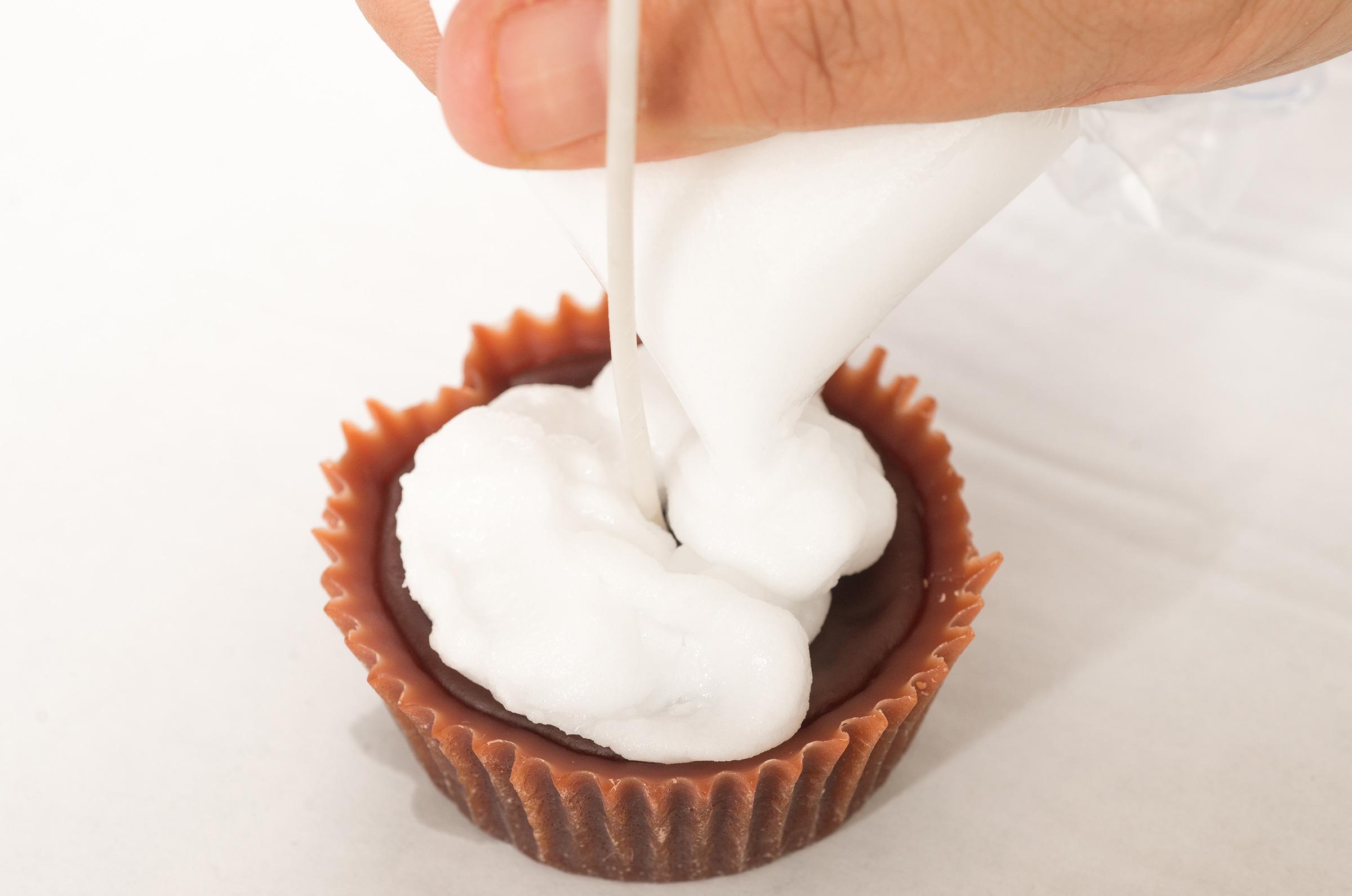 piping wax onto cupcake